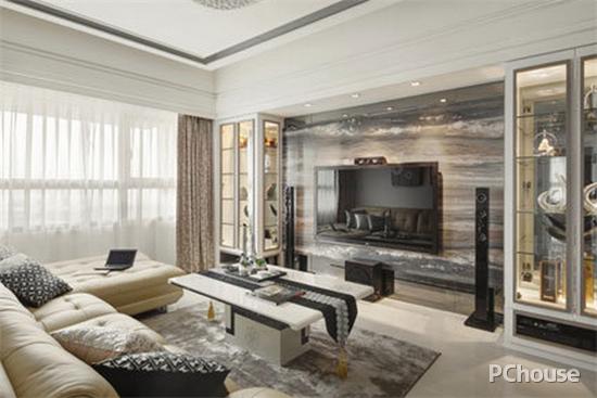 客厅的背景墙装修风格为北欧,呈现了一种温馨的感觉,中间的沙发是图片