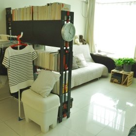 温馨客厅沙发布艺沙发书架装修图